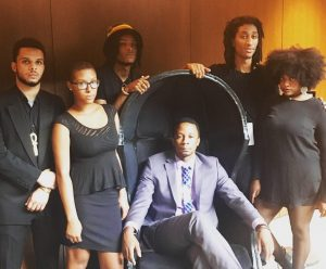 Split This Rock's Ushindi Performance Group, comprised of former members of the DC Youth Slam Team, after performing at the dedication for the Smithsonian's National Museum of African American History and Culture on September 24, 2016 (standing from left to right, Yonas Araya, Morgan Butler, Ayinde Grimes, Mandla Dunn, and Lauren May; with Acting Youth Programs Coordinator Joseph Green)